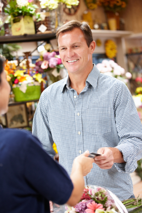 Man serving customer in florist