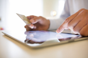 Use a business merchant account to accept credit card payments.