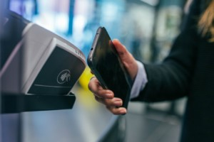 woman smart phone tap to pay